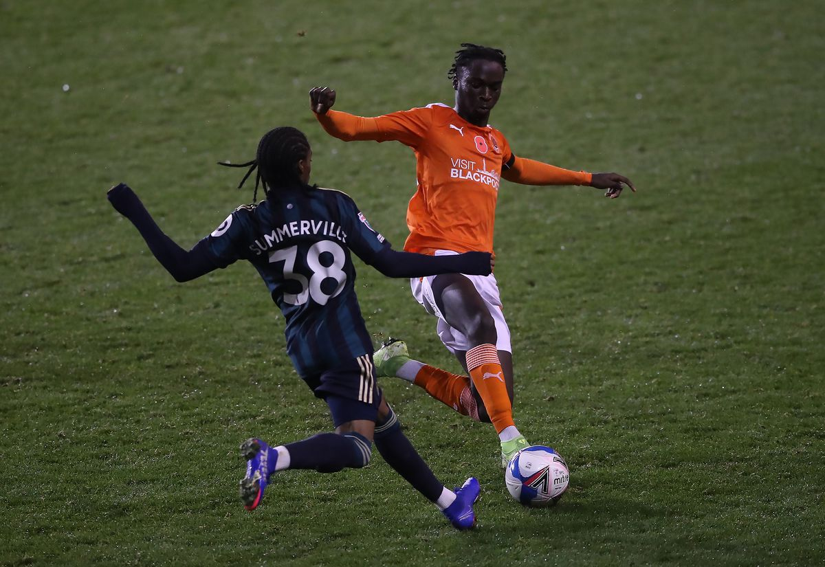 Blackpool's Cameron Antwi (right) challenges Leeds United's Crysencio Summerville
