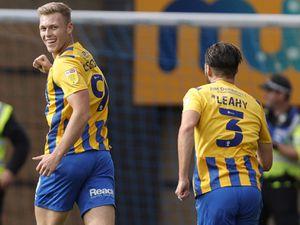 Sam Cosgrove of Shrewsbury Town celebrates after scoring a goal to make it 1-0.