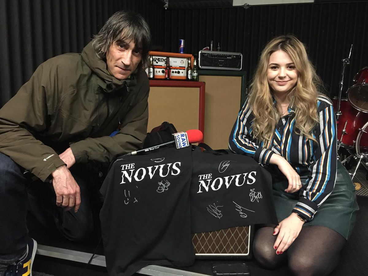Mark Piddington and fellow team-member Danielle Clarke pose with some signed The Novus t-shirts