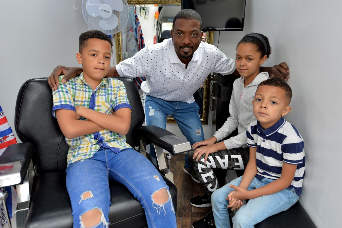 Wayne with his children, Nethan, 5, Lewis, 11, and Lacey,12