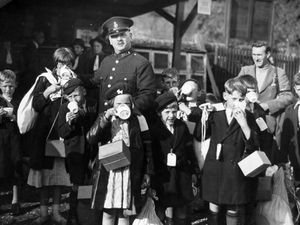 Today marks the anniversary of Britain's entry into the Second World War on September 3, 1939. Shropshire had already welcomed an influx of evacuees. These were arriving at Bridgnorth railway station, we think on September 2, and are having a drink while waiting for transport to take them to their new homes. The policeman's number is 333. Can anyone identify him?