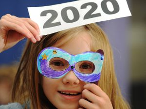 Making a 2020 mask to help bring in the New Year, Grace Pressdee, aged 10, of Ludlow, at Shropshire Hills Discovery Centre, Craven Arms