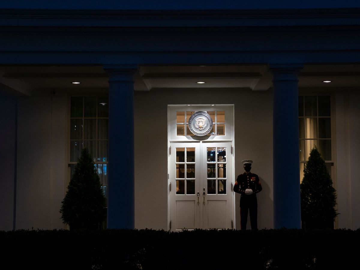 A Marine stands outside the West Wing of the White House, signifying President Donald Trump is in the Oval Office (Evan Vucci/AP)