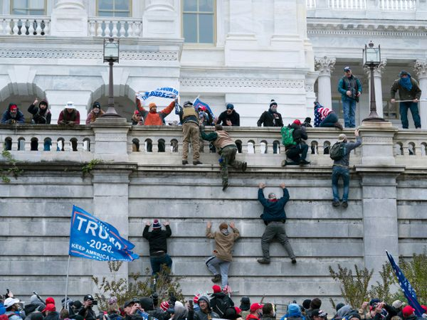 Supporters of President Donald Trump climbed the west wall of the the US Capitol