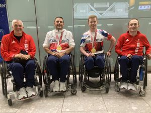 GB MCSI patients pictured from left, coach Paul Shaw; players Ryan Cowling and Jim Roberts; and assistant coach Darren Matthews after winning gold in the 2020 Paralympic Games in Tokyo