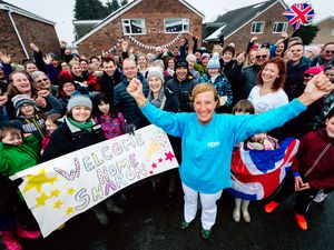 Atlantic rower Sharon Magrath was greeted by a large crowd when she arrived home in Bayston Hill