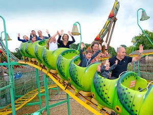 Visitors enjoy the caterpillar ride