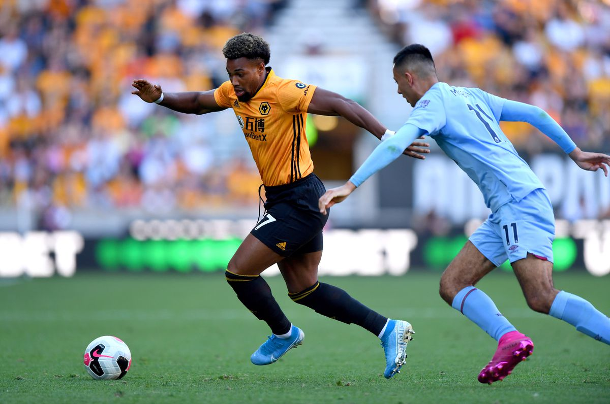 Adama Traore of Wolverhampton Wanderers and Dwight McNeil (AMA)