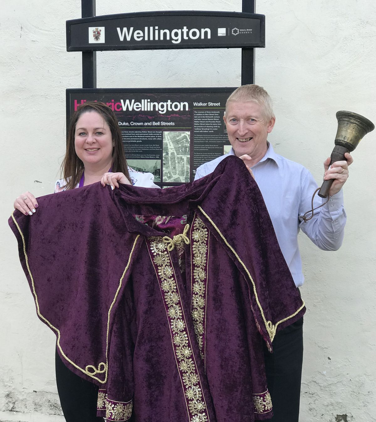Caroline Mulvihill and Andrew Roberts of Wellington Town Council with the town crier robe and bell