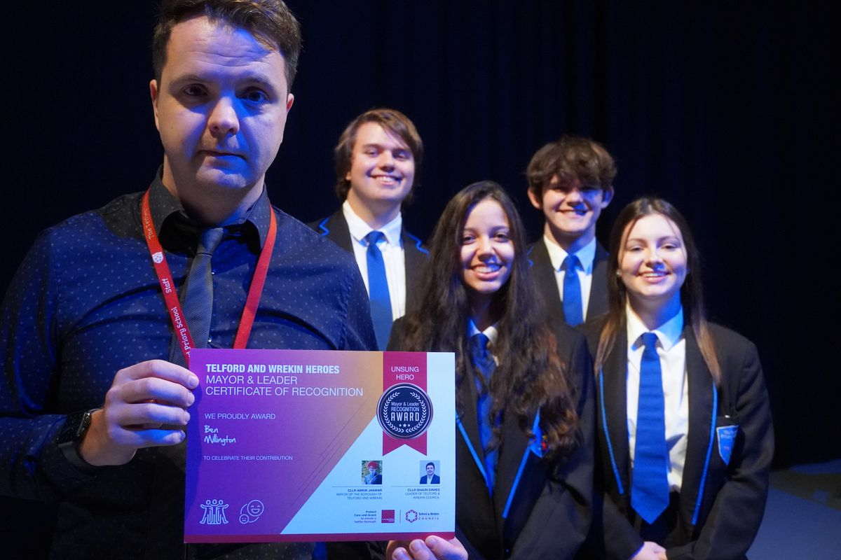 Ben Millington with students at the Telford Priory School