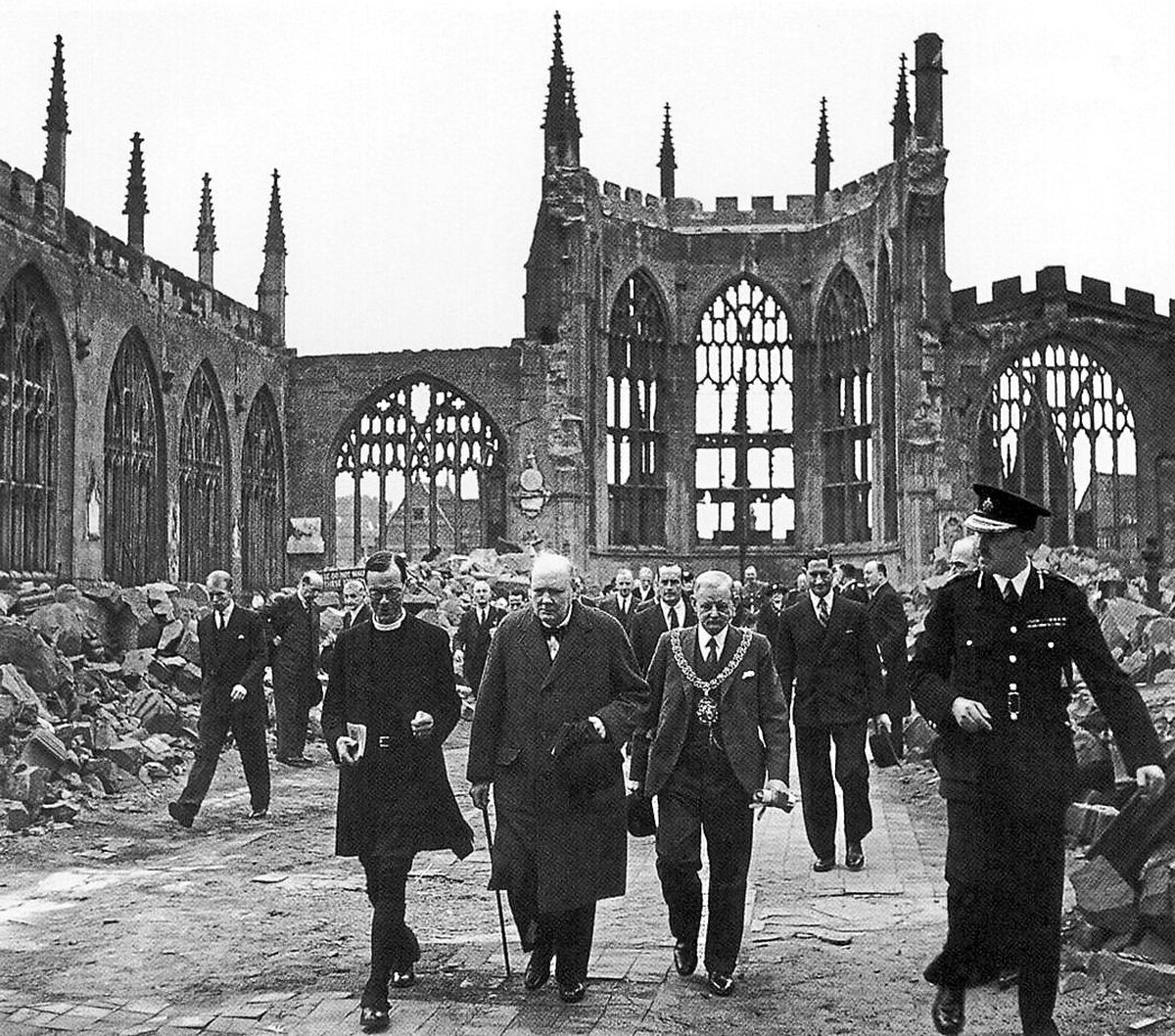 The Prime Minister Winston Churchill at Coventry Cathedral to assess the damage and meet people in the city. He beefed up air defences across the Uk after the attack.