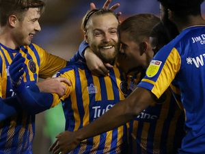 Harry Chapman of Shrewsbury Town celebrates after scoring a goal to make it 1-0.