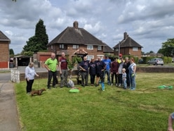 Telford community comes together to clean up memorial for the fallen