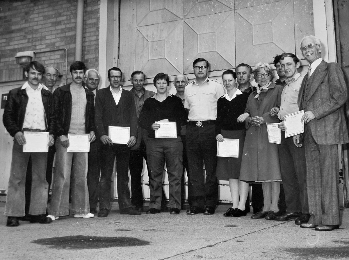 A presentation of awards to Donnington depot transport drivers. They include, fifth from right, (between two women), Gvoka or Govaka; middle, between the man with glasses and a woman, Knezevic; and on the other side of the same woman, Karpenko.