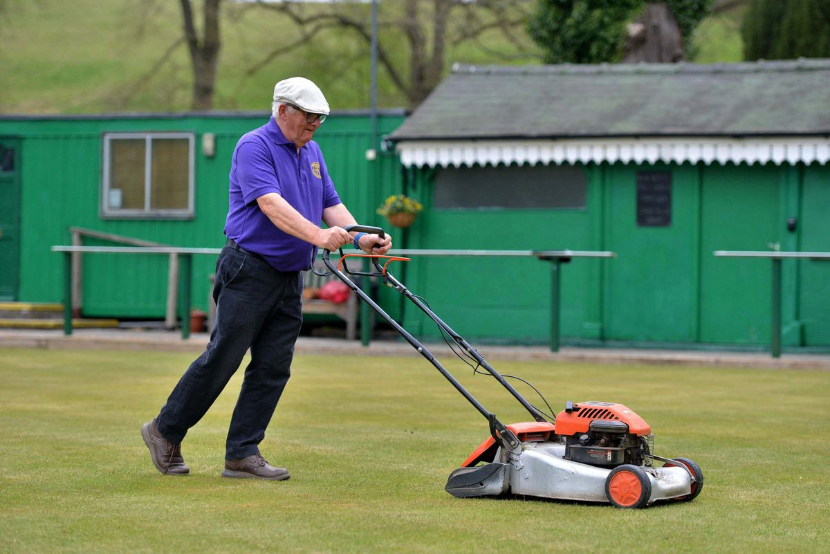 Members of the club spent hours throughout lockdown ensuring the green would be fit for purpose upon the club's reopening. In shot is secretary Mervyn Jarman