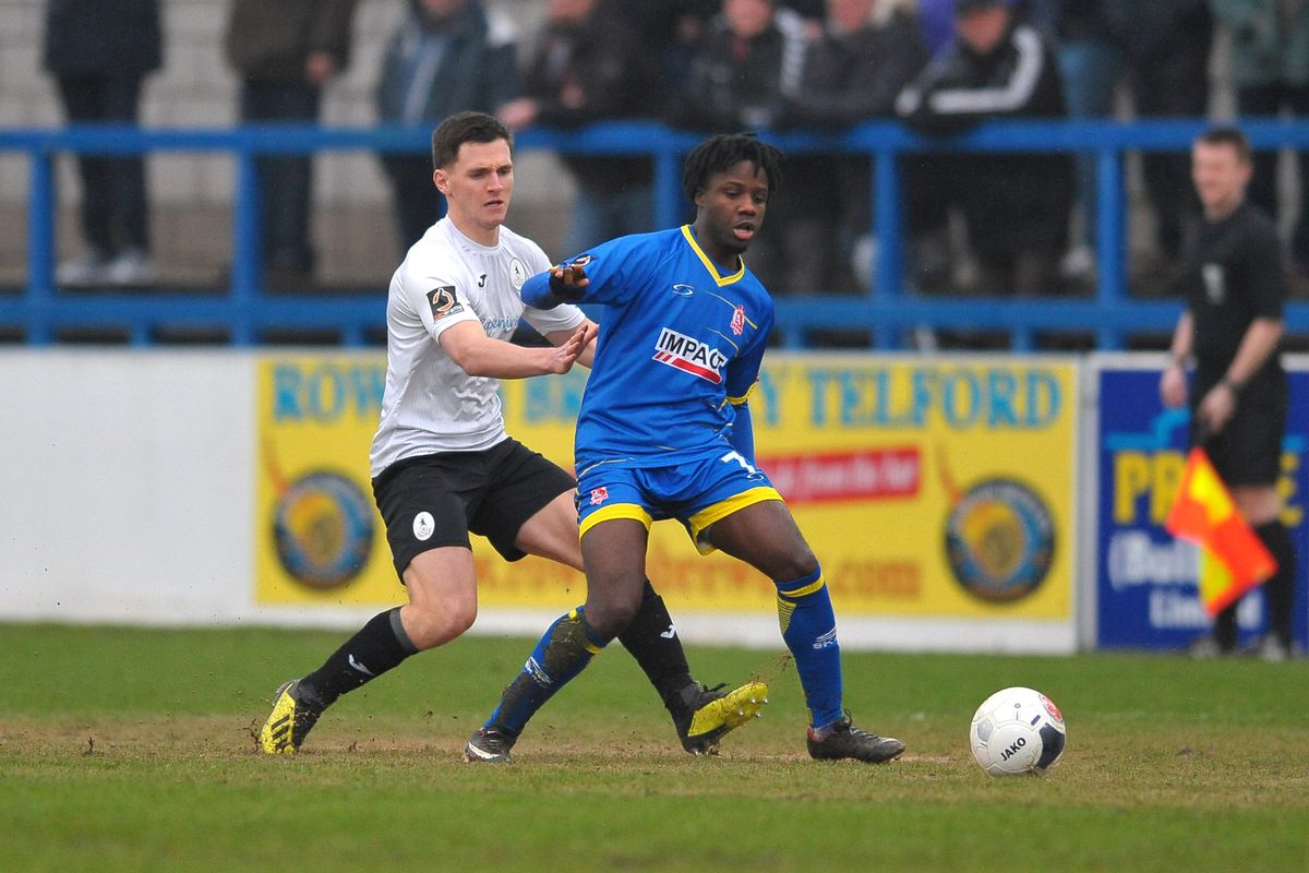 TELFORD COPYRIGHT MIKE SHERIDAN Ross White of Telford closes down Jude Oyibo during the Vanarama Conference North fixture between AFC Telford United and Alfreton Town at the New Bucks Head Stadium on Thursday, December 26, 2019...Picture credit: Mike Sheridan/Ultrapress..MS201920-036.