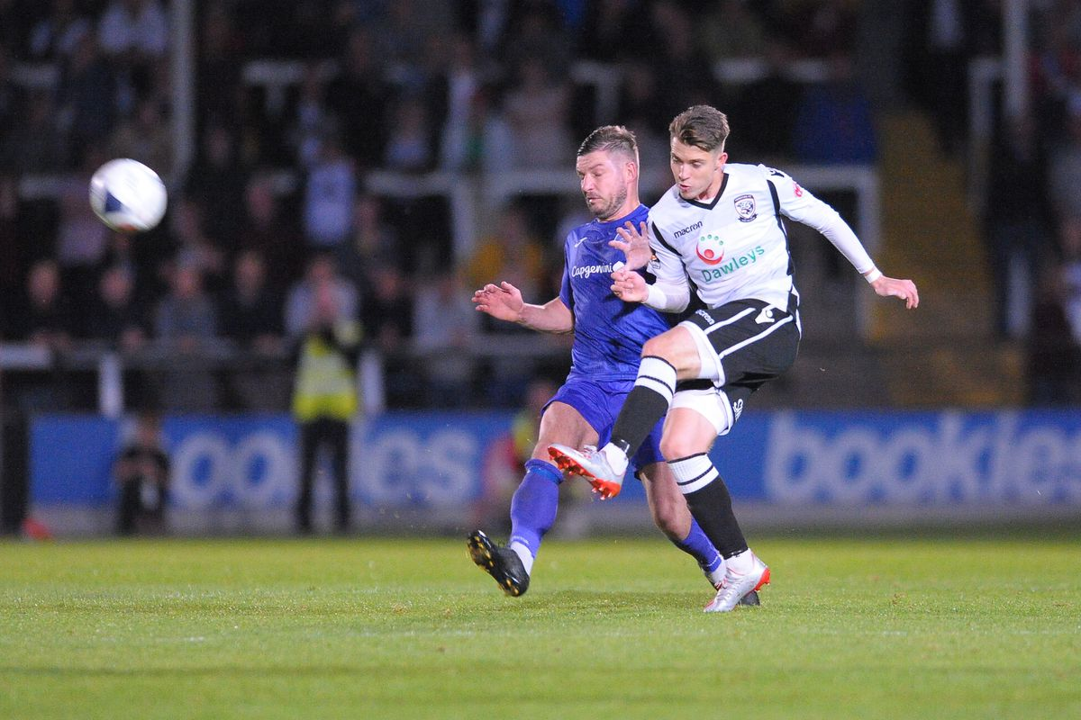 Steph Morley of Telford battles for the ball with Jacob Jagger-Cane of Hereford