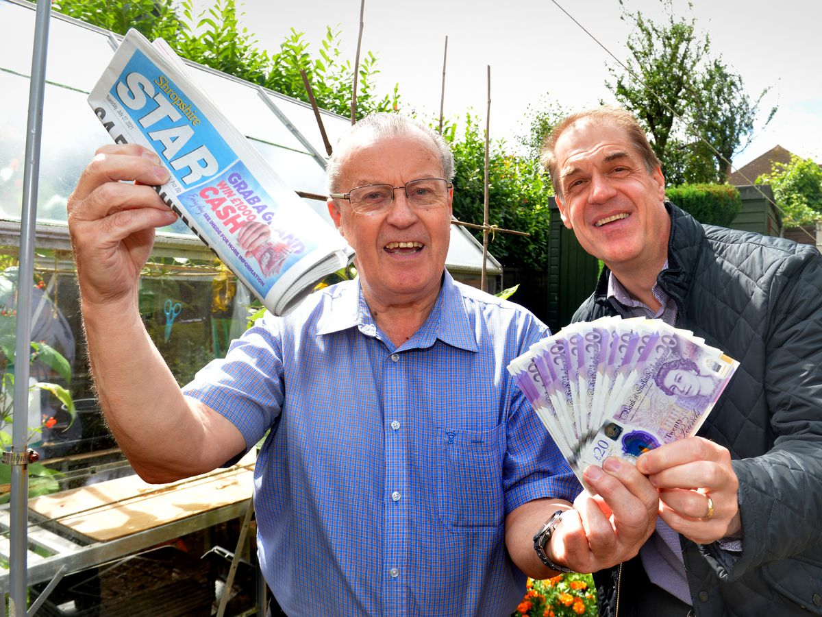 Grab a Grand winner Roger Martin with the Star's sales and promotions manager Andy Maxwell