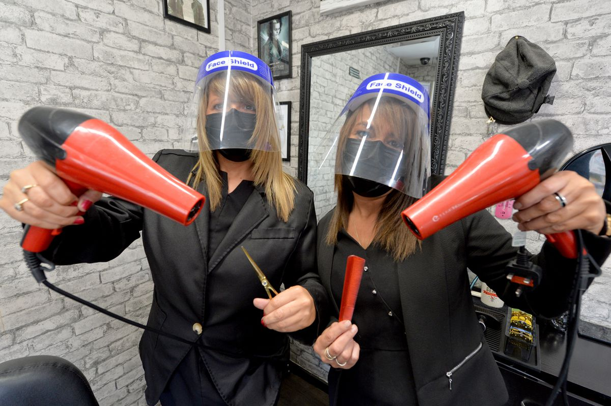 Charlotte Pritchard, left, and Kerry Evans have been business partners for more than 15 years. They run Boys2Men Traditional Barbers in Heath Hill, Dawley.