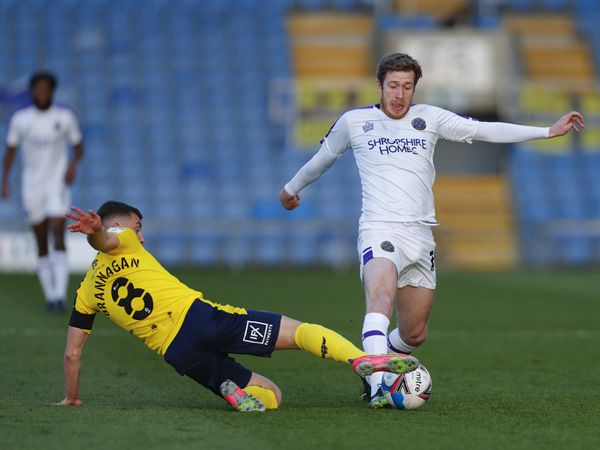Cameron Brannagan of Oxford United and Josh Vela of Shrewsbury Town.