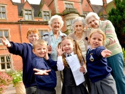 Schoolchildren and elderly on song for Shropshire care home concert - in pictures and video