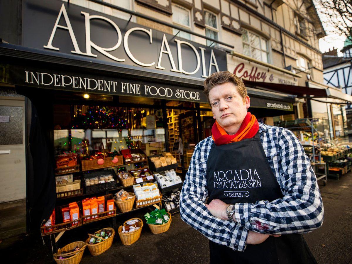 Mark Brown in front of his Arcadia delicatessen