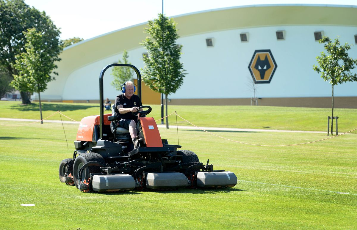 Groundsman Ken Bates cuts the grass at Compton Park training ground