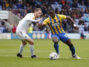 Dan Udoh of Shrewsbury Town and Adam May of Cambridge United (AMA)