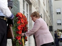 Merkel urges Europeans to confront populism after tribute to Nazi resistance