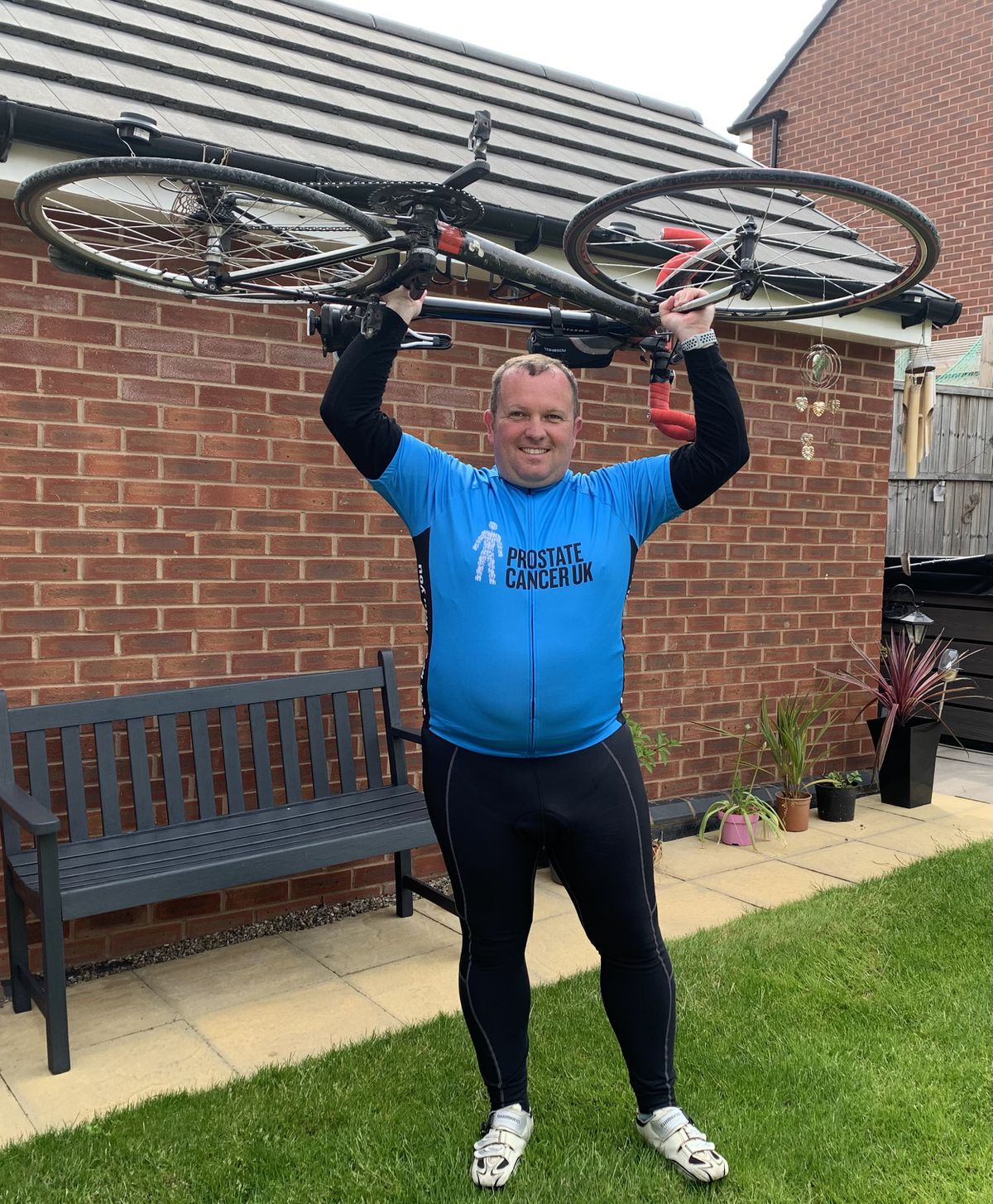 Dave Prince completing his 200-mile cycling challenge in aid of Prostate Cancer UK.