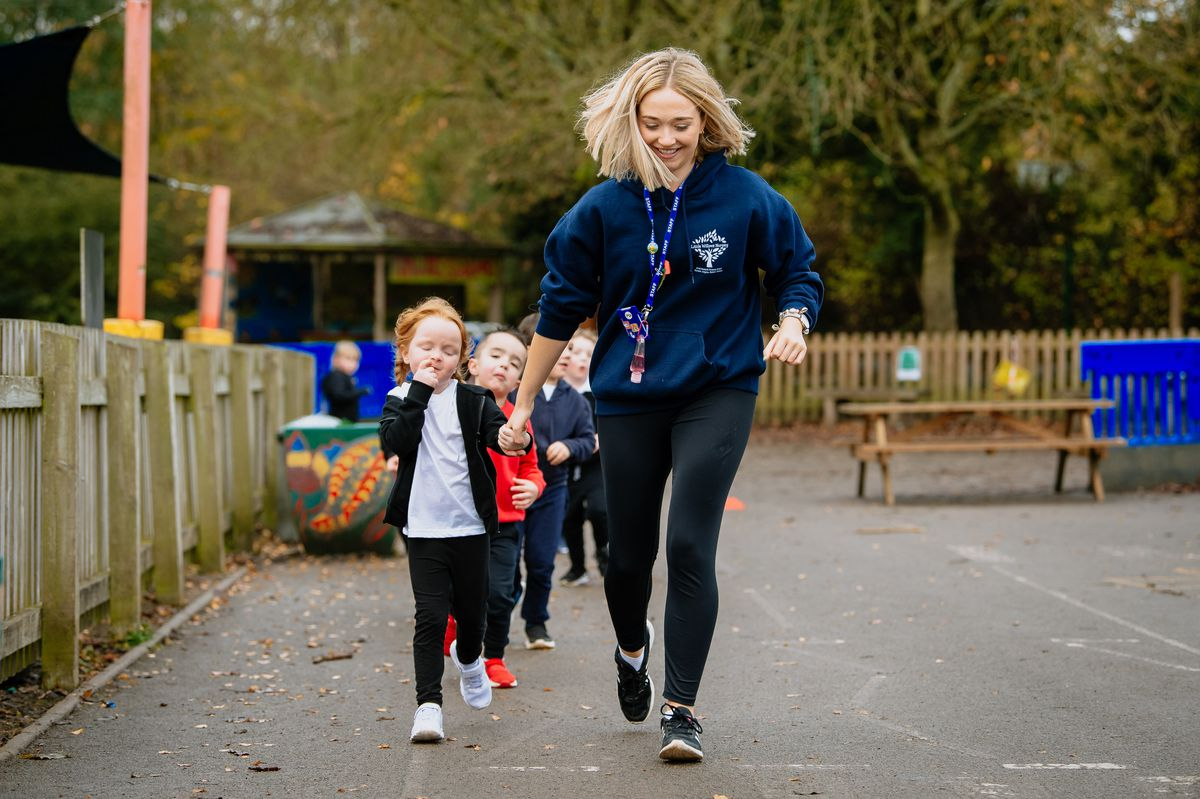 Molly Davis with pupils at Much Wenlock Primary School
