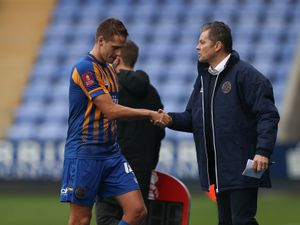 David Edwards of Shrewsbury Town shakes hands with Steve Cotterill the head coach / manager of Shrewsbury Town as he goes off injured. (AMA)
