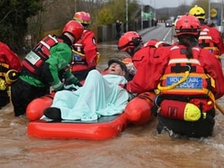 Elderly man trapped by floods evacuated from house