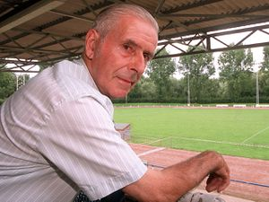 Oswestry Town Football Club chairman Bill Jerman looks out over the Park Hall Stadium.