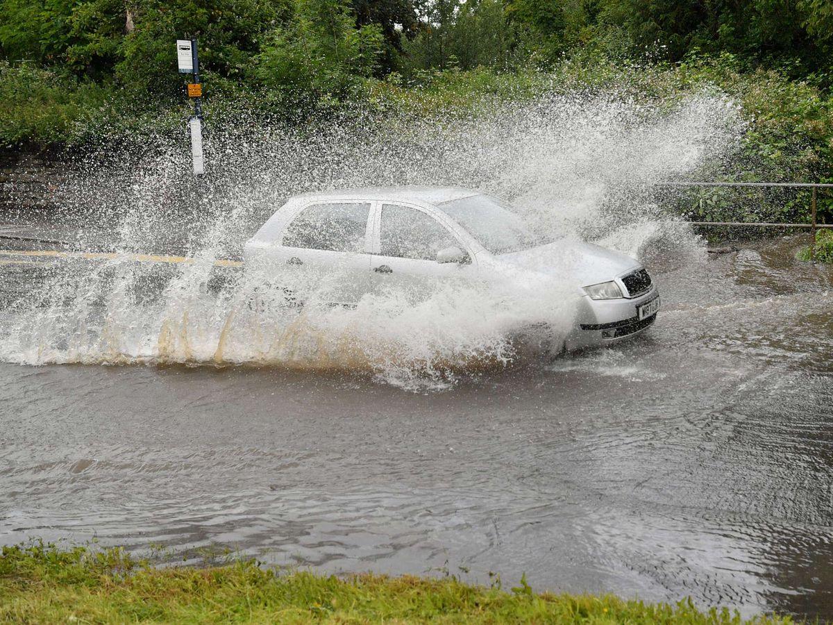Car driving in rain
