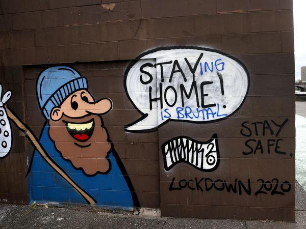 A cyclist passes coronavirus-related graffiti in Glasgow