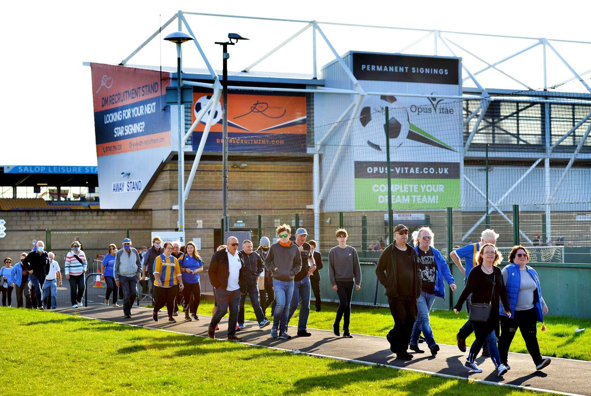Shrewsbury Town fans make their way home after the side's 2-1 loss to Northampton