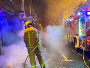 Firefighters put out the fires on the High Street