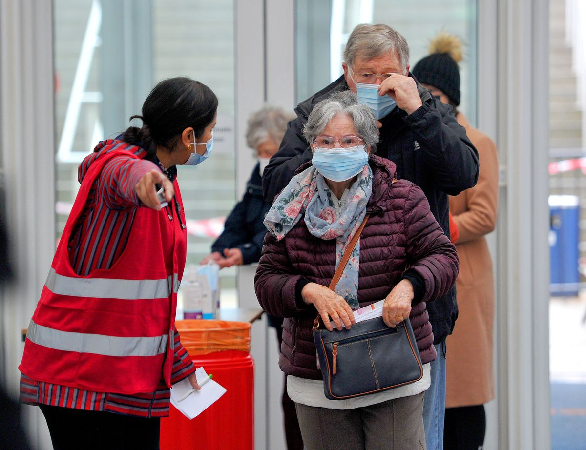 Patients arrive at Telford International Centre to get their jabs