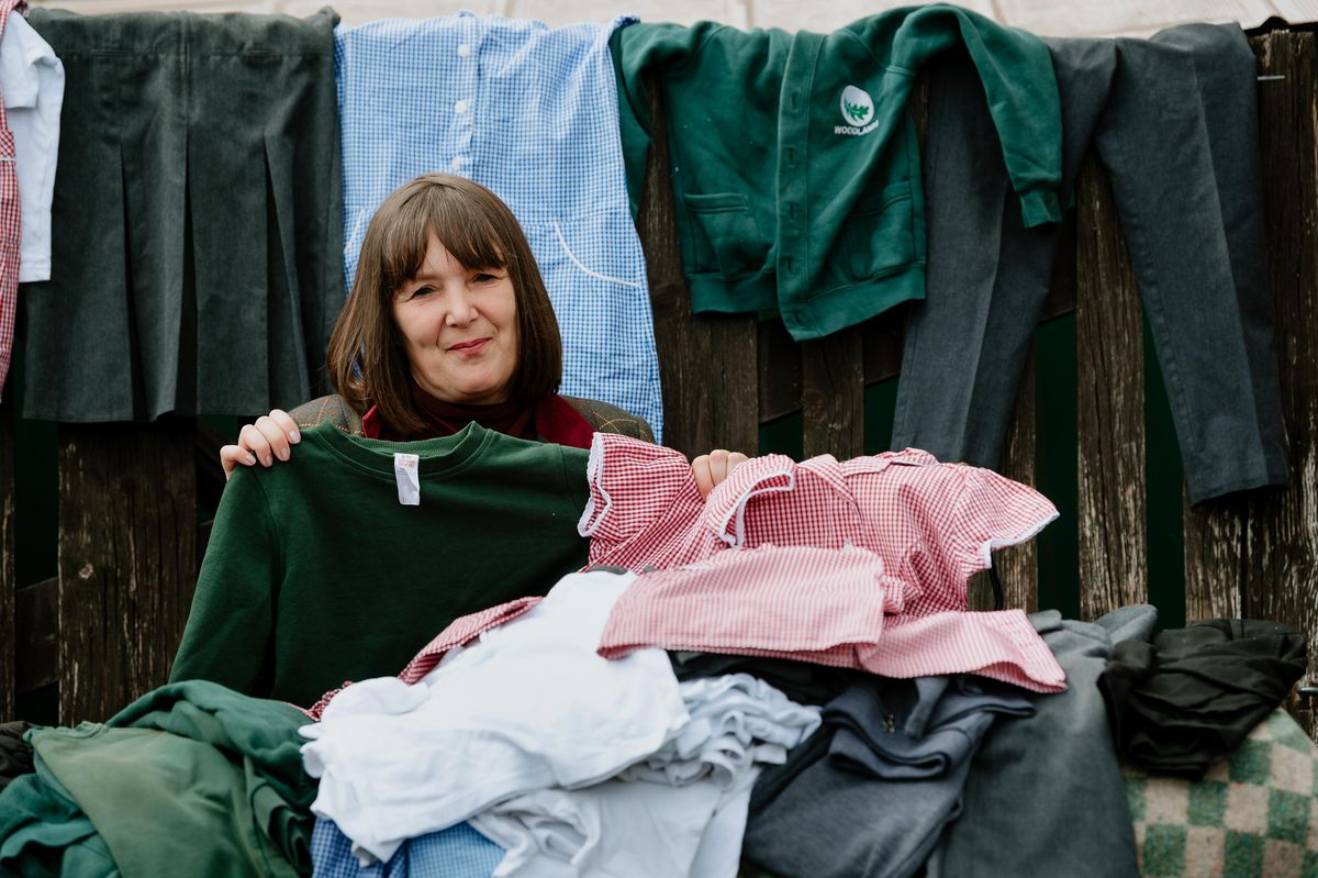 Kelly Middleton, of the Telford & Wrekin school uniform appeal, with some of the clothing already collected for the expanding project