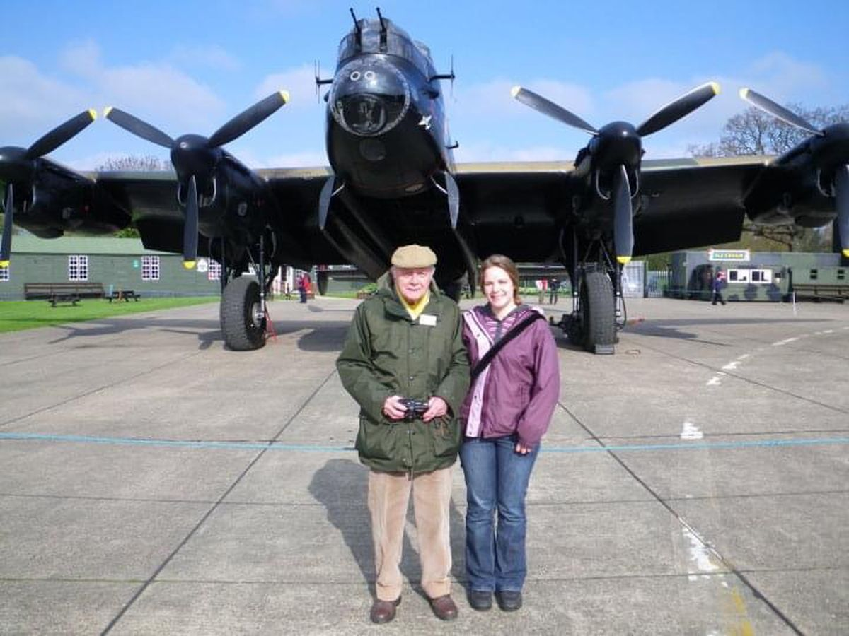 Wilfred Dawson and his granddaughter Susie Phillips in front of a Lancaster at a museum in East Kirkby