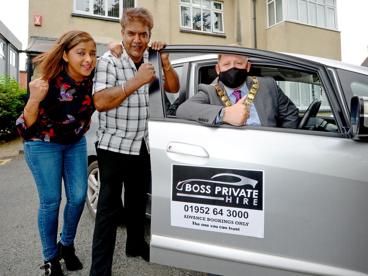 A new independent taxi firm called Boss Private Hire, has been started in Telford by husband and wife duo Lalit and Baljit Bains. Mayor of Wellington Councillor Paul Davis helps them to celebrate.