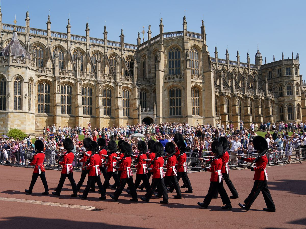 Members of the 1st Battalion Grenadier Guards arrive for the Changing of the Guard at Windsor Castle in Berkshire