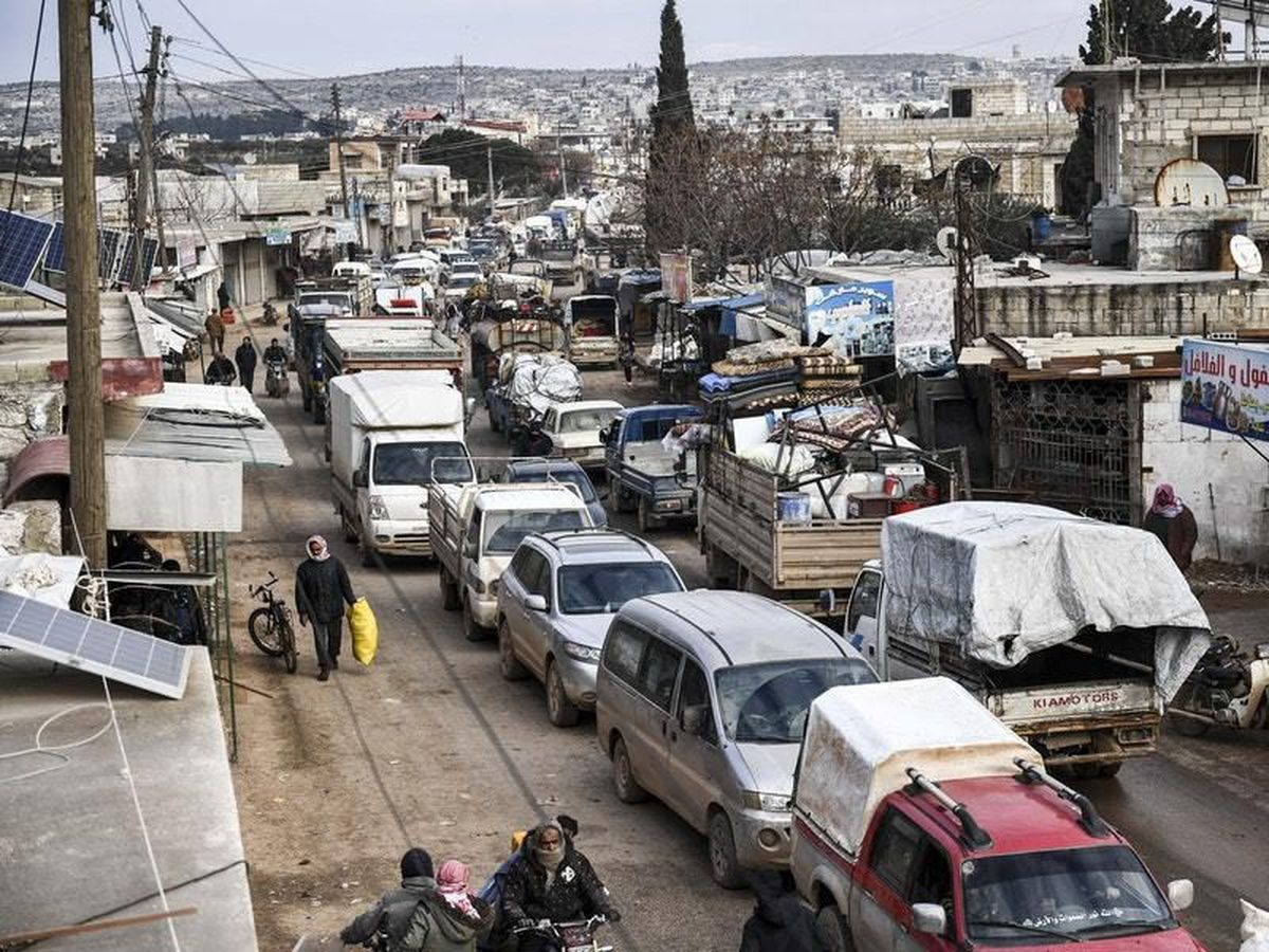 Civilians flee from Idlib towards the north to find safety inside Syria near the border with Turkey