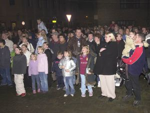Crowds wait for the switching on of the Ludlow Christmas lights