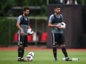 Joao Moutinho of Wolverhampton Wanderers and Ruben Neves of Wolverhampton Wanderers.