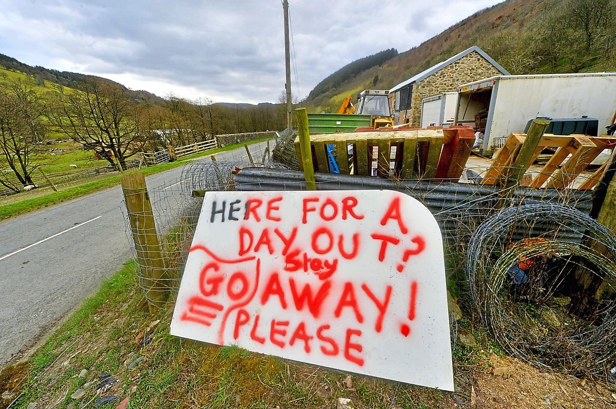 Locals make their feelings known to any English visitors near Coed Wood, on the way to Lake Vyrnwy in Wales as lockdown stays