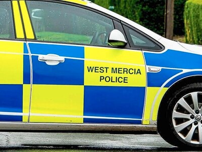 Police officer injured as car hits high street wall
