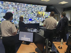 The policing minister in the CCTV control room