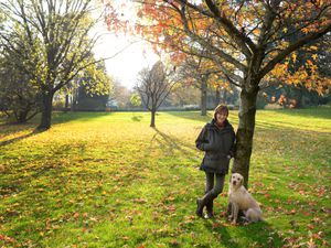 Enjoying the autumn colours with her dog Bess is Kathryn Robey, curator of the Dorothy Clive Garden near Market Drayton
